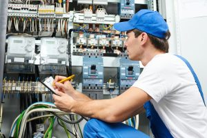Young adult electrician builder engineer inspecting electric cou